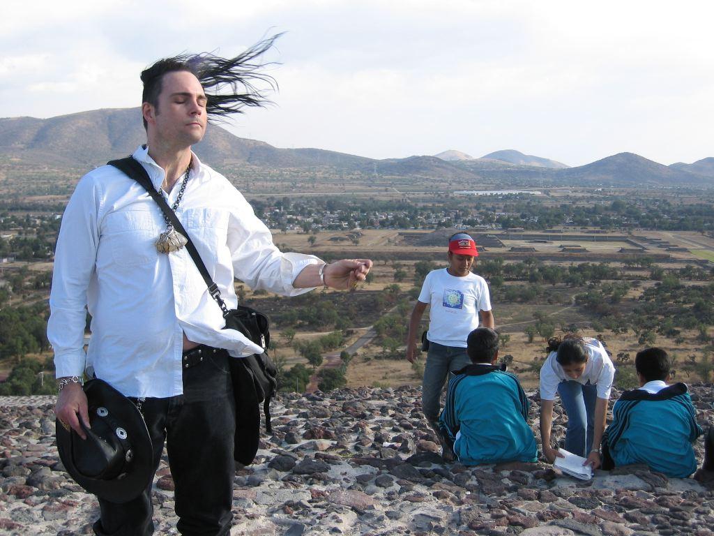 Marc playing air guitar at the top of Pyramida del Sol