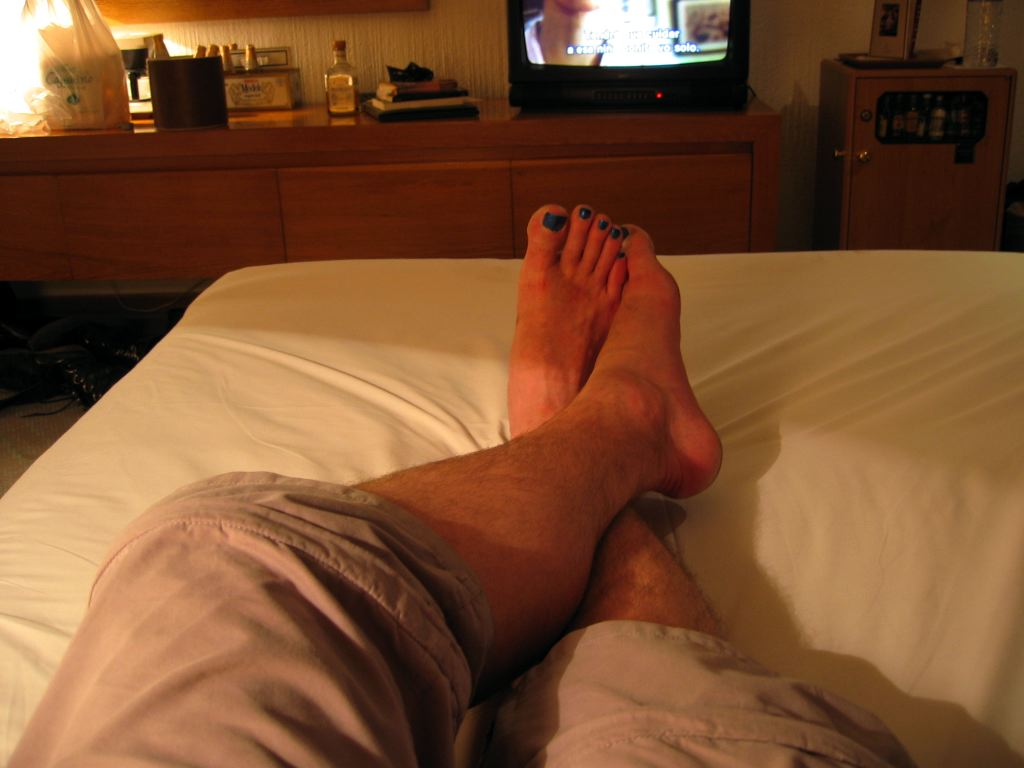 My feet in our hotel room with the wrong white-point setting.  A beautiful shot!