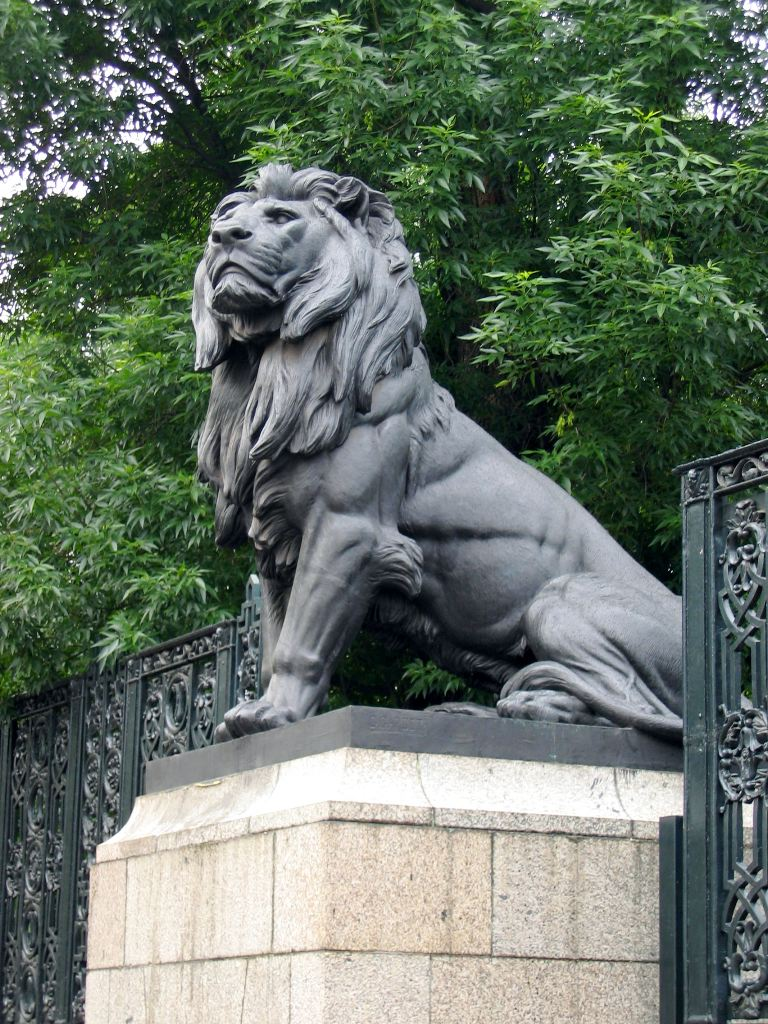 Metal lion guarding the gate from really big magnets