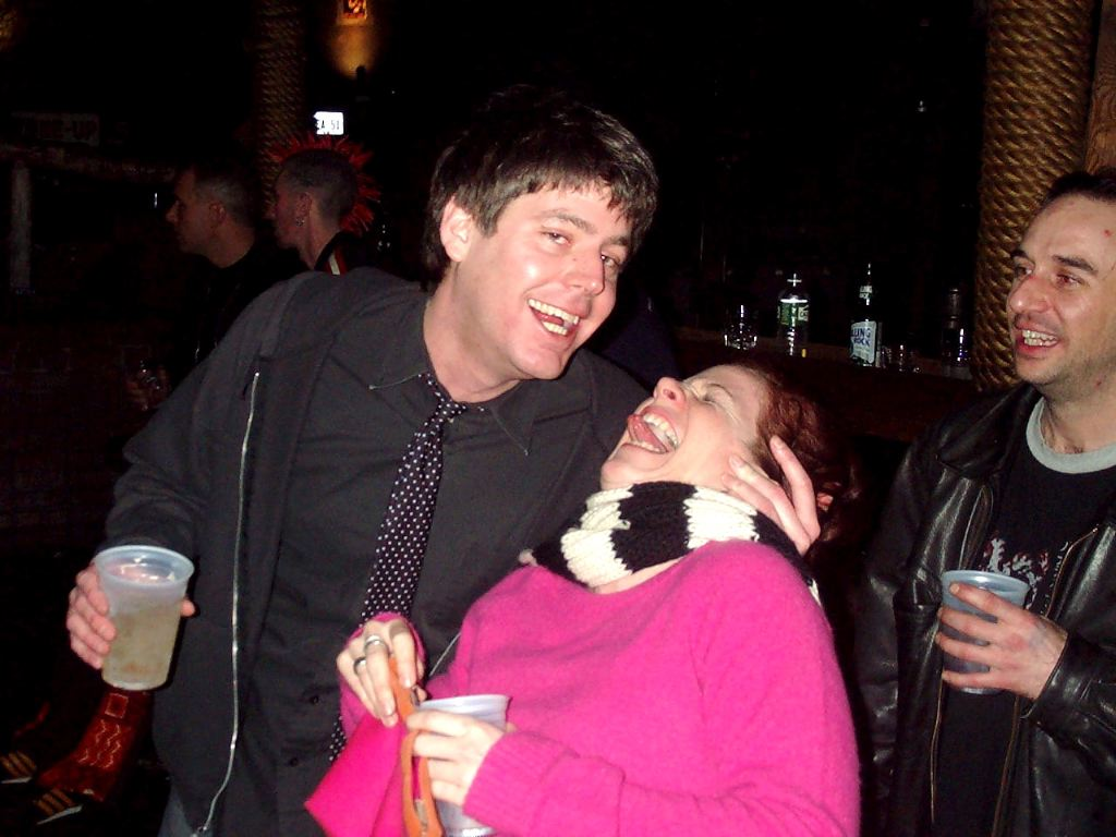 Check out the mohawk in the background!  Oh, and Mark's gonna kiss my woman.