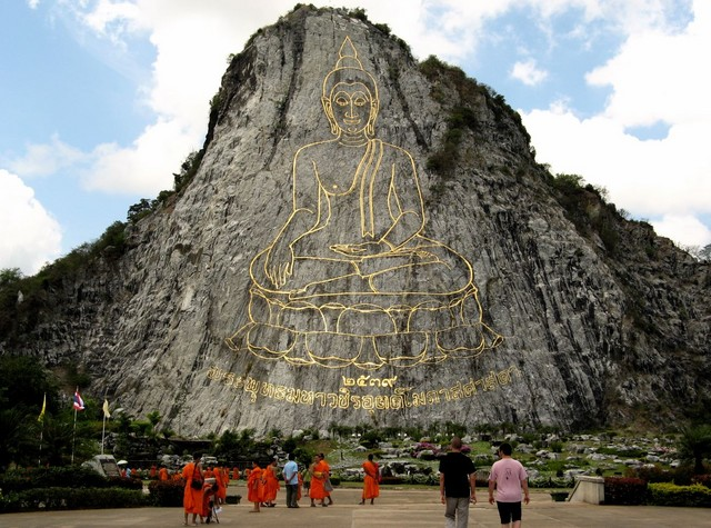 Lots of tiny monklets dwarfed by Giant Buddha